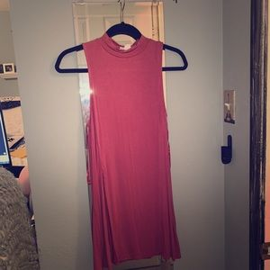 sleeveless long tunic with long slit on the side
